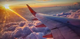 Picture of an airplane wing and sunset view